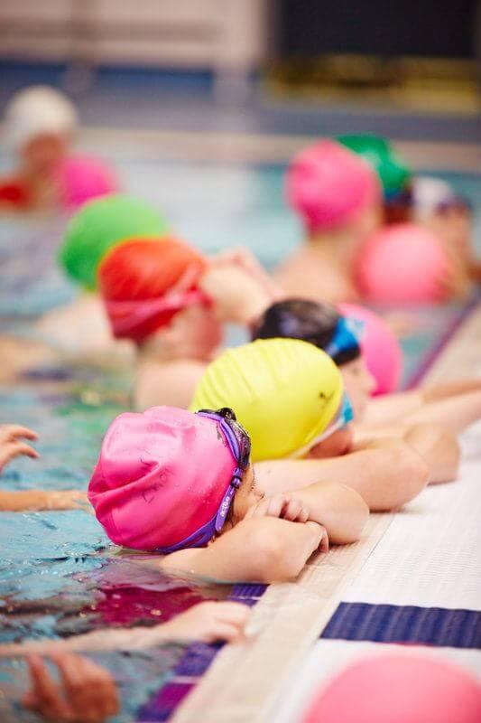 Kids swimming at camp